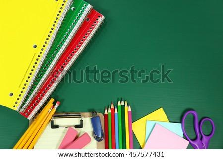 Back to School Supplies on Blank Chalkboard - stock photo