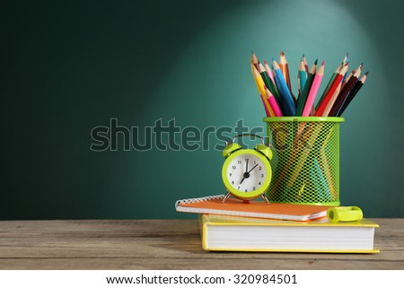 Back to school template on green chalkboard background - stock photo