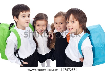 Back to school theme with group of children having backpacks - closeup
