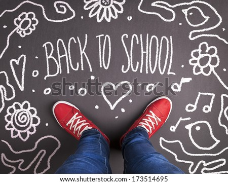 Back to school theme with hand drawn chalk sketched text on blackboard. - stock photo