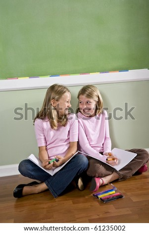 Back to school - two 8 year old girls doing homework together