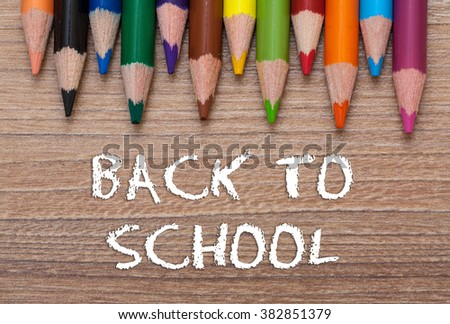Back to school words - Concept frame of multicolored pensils on wood background - stock photo