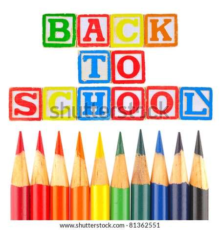 Back to School Written in Alphabet Blocks with Colored Pencils - stock photo