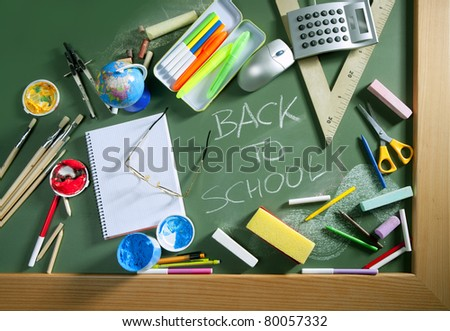 Back to school written in green blackboard education concept still life - stock photo