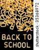 Back to school written in kids alphabet soup pasta. - stock photo
