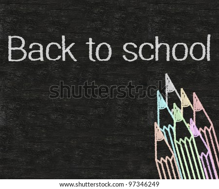 back to school written on blackboard background with colors pencil