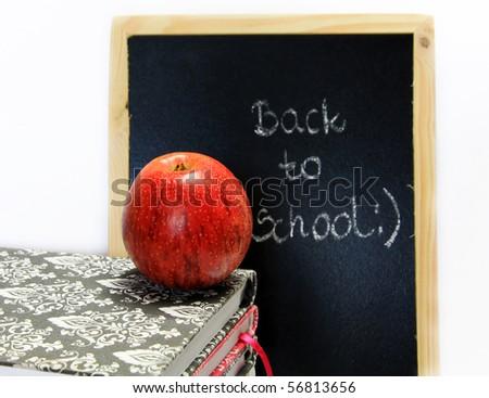 back to school written on chalkboard - stock photo