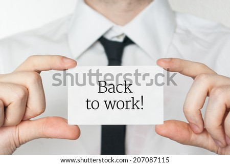 Back to work. Businessman in white shirt with a black tie showing or holding business card