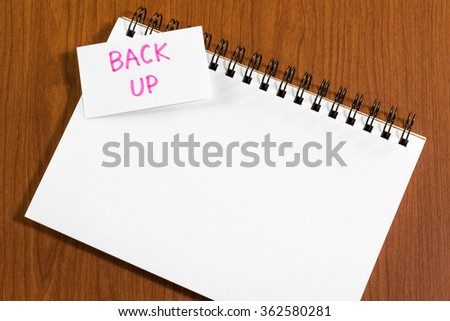 Back Up; White Blank Documents with Small Message Card. - stock photo