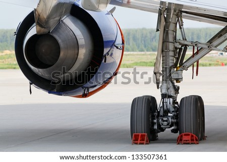 Back view at turbojet aeroengine and undercarriage - stock photo
