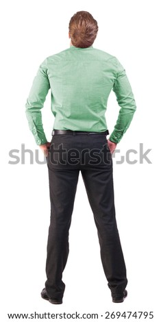 back view Business man  looks ahead.   backside view of person.  Isolated over white background. broad-office worker with his hands in his pockets looking to the sky - stock photo