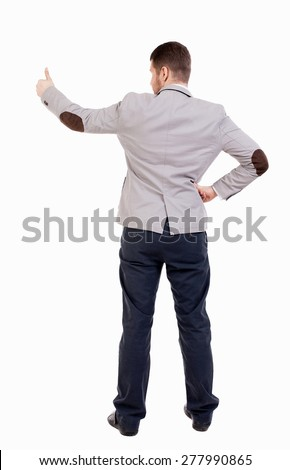 Back view business man shows thumbs up.  Isolated over white background. office worker with two hands showing symbol of success. Putting his hand on the waist, other hand businessman showing his thumb - stock photo