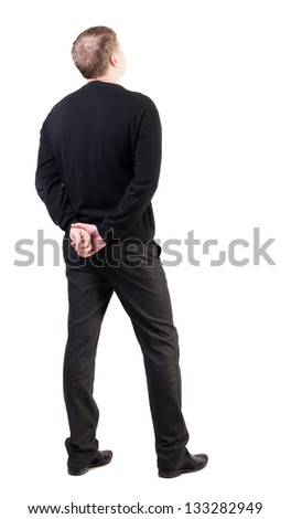 back view Businessman looks ahead. Young guy watching. Rear view people collection. backside view person. Isolated over white his hands clasped behind his back office worker looks at the sky - stock photo