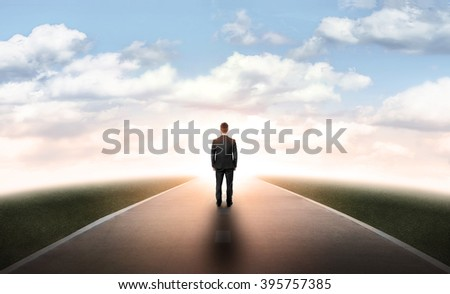 Back view businessman walking straight on his way - stock photo