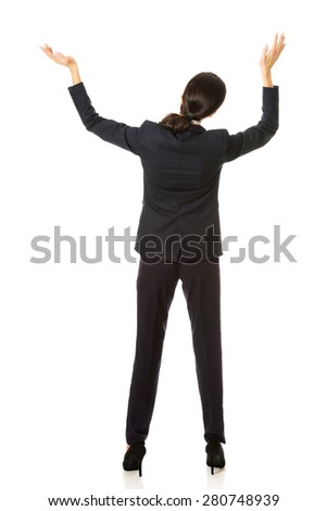 Back view businesswoman holding copyspace. - stock photo