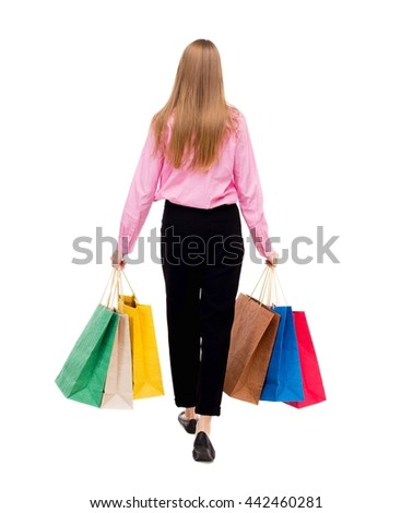 back view going  woman  with shopping bags. beautiful girl in motion. backside view of person. Rear view people collection. Isolated over white background. Woman businessman went off with a lot bags - stock photo