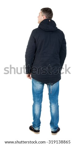 Back view handsome man in winter jacket  looking up.   Standing young guy in parka. Rear view people collection. backside view of person. Isolated over white background. man in jacket looking to right - stock photo