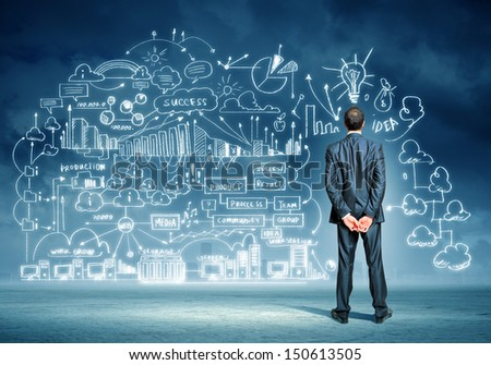 Back view image of young businessman standing against business sketch - stock photo