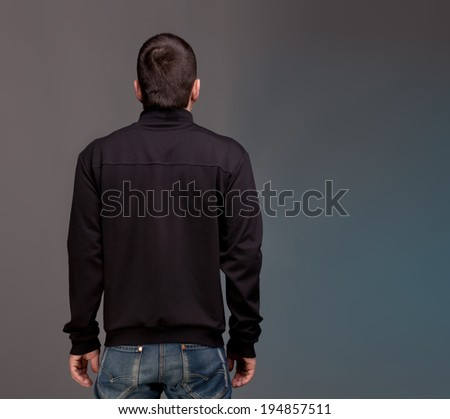 Back view.Male person in black - stock photo