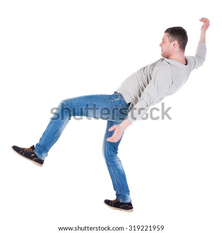Back view man Balances waving his arms. Rear view people collection. backside view of person.  Isolated over white background. the falling man balancing on one leg. - stock photo