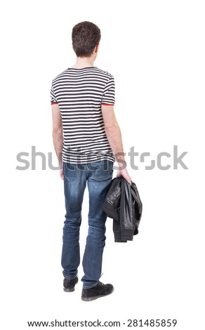 Back view man in jeans. Standing young guy. Rear view people collection.  backside view person.  Isolated over white background. The guy in the striped shirt standing and holding a jacket in his hand. - stock photo