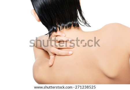 Back view nude woman touching her nape. - stock photo