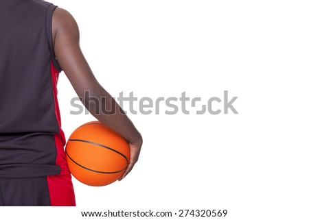 Back view of a basketball player holding a ball, isolated on white background - stock photo