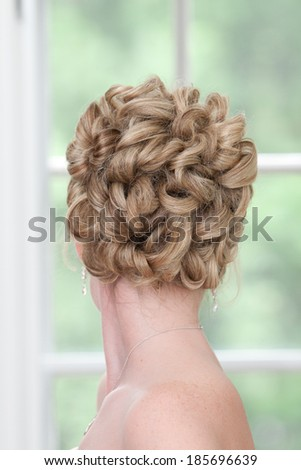 Back View of a Blonde Woman's Knotted Hair Bun - stock photo