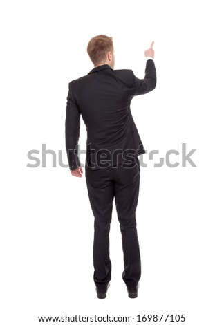 Back view of a business man pointing finger - stock photo