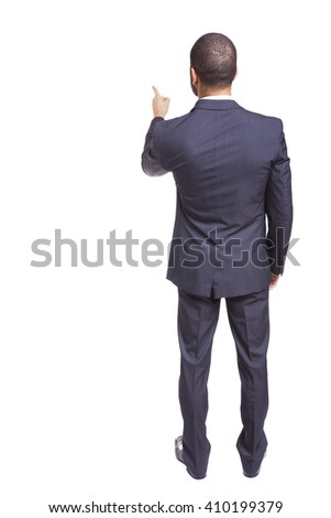 Back view of a businessman pointing at at something, isolated on white background - stock photo