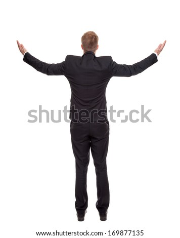 Back view of a businessman presenting your ad - stock photo