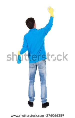 Back view of a cleaner man in gloves with sponge and detergent. girl  watching. Rear view people collection.  backside view of person.  Isolated over white background. Man cleaner washes a wall - stock photo
