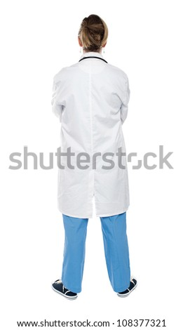 Back view of a female doctor looking at white. Full length shot