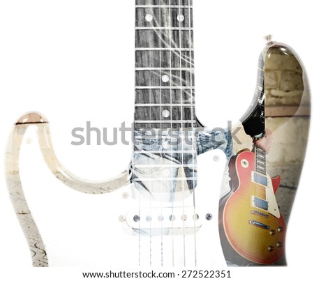back view of a man holding a guitar and guitar silhouette in double exposure - stock photo
