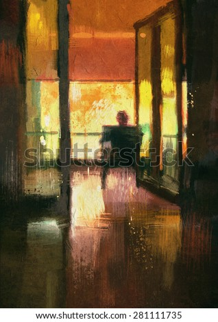 back view of a man sitting on chair looking the view outside - stock photo