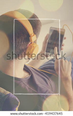 Back view of a man with headphones. Selective focus.  - stock photo