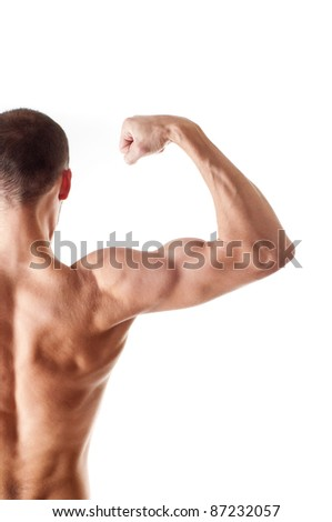 back view of a muscular young man showing his biceps isolated on white - stock photo