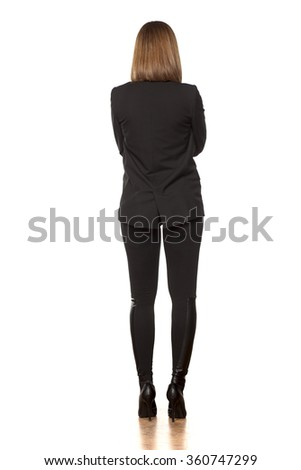 Back view of a pretty business woman on white background