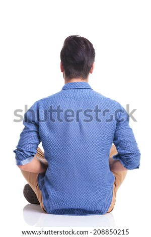 back view of a seated young brunette man , on white background - stock photo