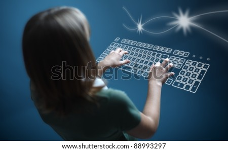 Back view of a teenager girl, typing on virtual keyboard - stock photo