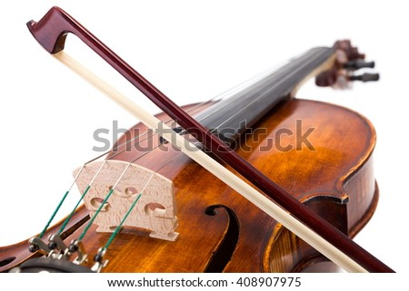 Back view of a violin with the bow on the strings - stock photo