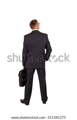 Back view of a walking business man with a notebook case and looking to a side, full length portrait isolated on white background - stock photo