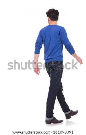 back view of a walking casual man looking to a side on white background - stock photo