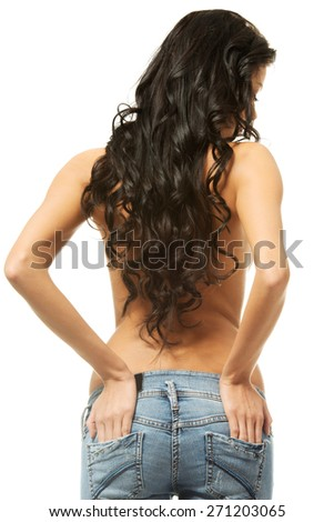 Back view of a woman shirtless wearing jeans. - stock photo
