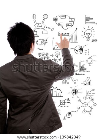 Back view of a young business man writing financial graph against white background - stock photo
