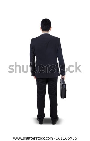 Back view of a young businessman standing with briefcase isolated on white background - stock photo