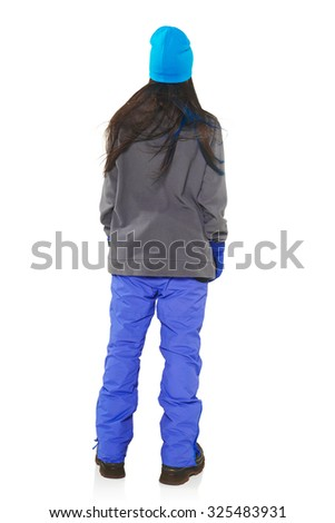 Back view of a young woman in winter sport clothing standing in full length, isolated on white background - stock photo