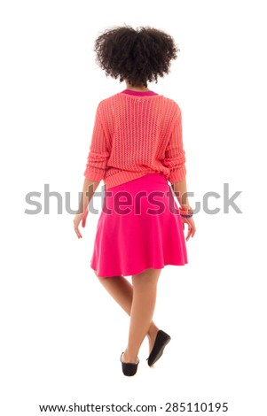 back view of african american teenage girl in pink posing isolated on white background - stock photo