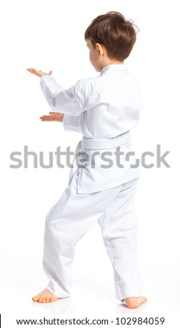 Back view of aikido boy fighting position in white kimono isolated on white - stock photo