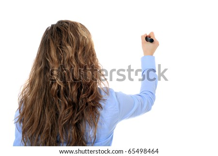 Back view of an attractive young girl using a marker. All on white background. - stock photo